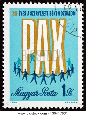 HUNGARY - CIRCA 1969: a stamp printed in Hungary shows PAX and Men Holding Hands 20th Anniversary of Peace Movement circa 1969
