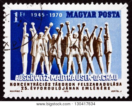 HUNGARY - CIRCA 1970: a stamp printed in Hungary shows Monument to Hungarian Martyrs by A. Makrisz 25th Anniversary of the Liberation of the Concentration Camps circa 1970