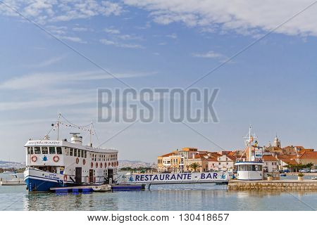Seixal, Portugal. September 10, 2015: Seixal city entrance in Setubal District, Portugal. Also shown a floating bar restaurant built in an old ferry (Cacilheiro).