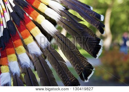 Multi-colored feathers of an Indian national headdress close up