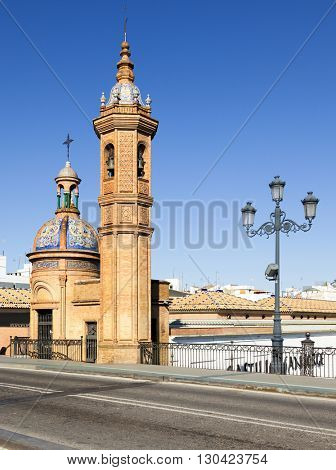 Bell tower and dome of the Castillo de San Jorge museum, as seen from the Triana bridge