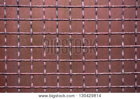 Rusty metal wire cage, abstract background metallized