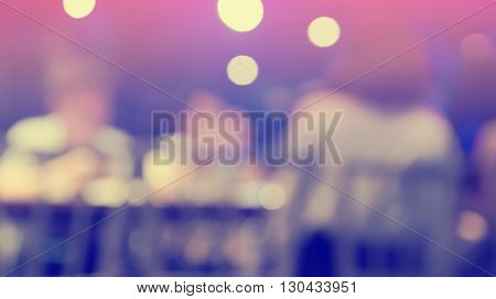 Blurred defocused of light in pub city abstract background purple and violette tone