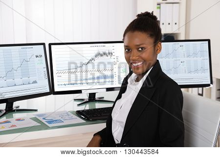 Photo Of Young African Stock Broker In Office