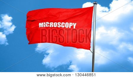 microscopy, 3D rendering, a red waving flag