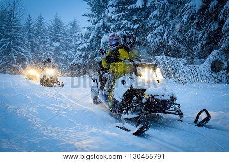 Snow Mobile in the dark blizzard canada