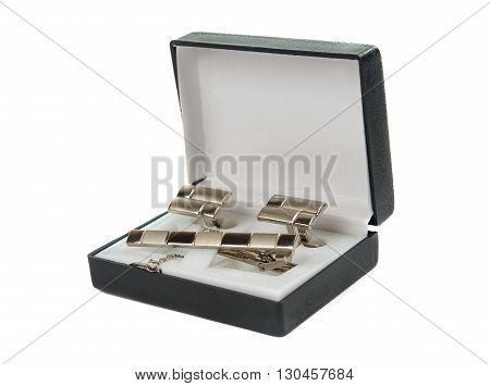 platinum, metal cufflinks on a white background