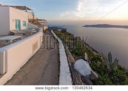 Amazing sunset in town of Imerovigli, Santorini island, Thira, Cyclades, Greece
