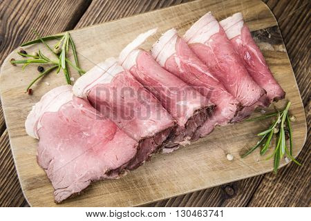 Old Wooden Table With Sliced Roastbeef
