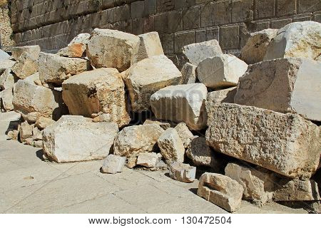 Fallen stone blocks from a section of the wall surrounding the Temple mount (Wailing wall) which was destroyed by roman soldiers.