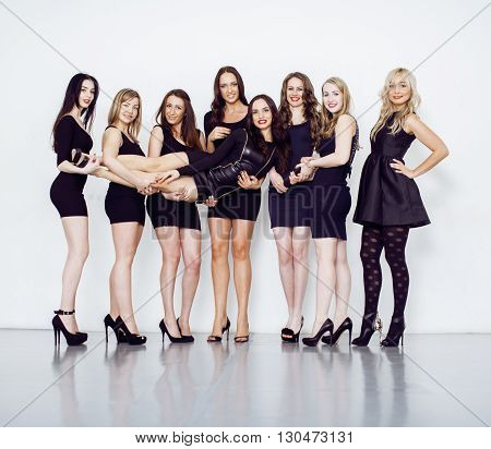 Many diverse women in line, wearing fancy little black dresses, party makeup, vice squad concept adorable