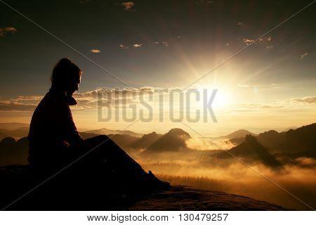 Beautiful  Young Long Hair Girl Tourist Enjoy Daybreak On The Sharp Corner Of Sandstone Rock And Wat