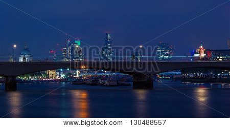 London UK - May 11 2016 - London cityscape at night including St Paul's Cathedral OXO Tower and Waterloo Bridge