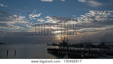 Sunrise over Puerto Juarez boat dock in Cancun Mexico