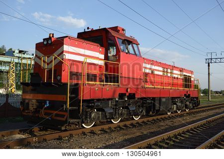 electric shunting locomotive red on spare rails