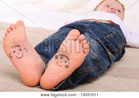 Small faces painted on the soles