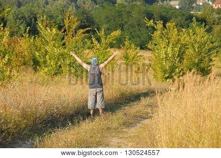 Rejoicing man on the field in Ukraine