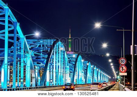 View of downtown traffic at Dongjak Bridge and Seoul tower over Han river in Seoul South Korea.