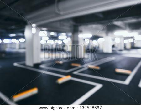 Blurred car park Indoor Building Basement with Neon Lighting