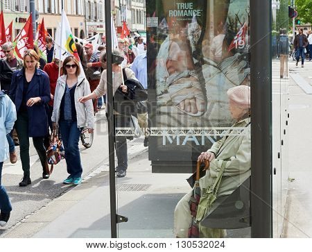 Senior Woman Watching Protestor