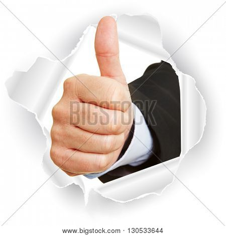 Hand breaking through paper and holding thumbs up as concept for business success