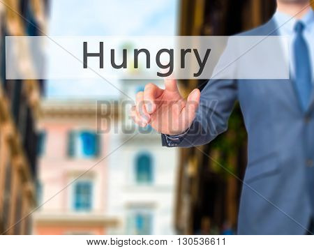 Hungry - Businessman Hand Pressing Button On Touch Screen Interface.