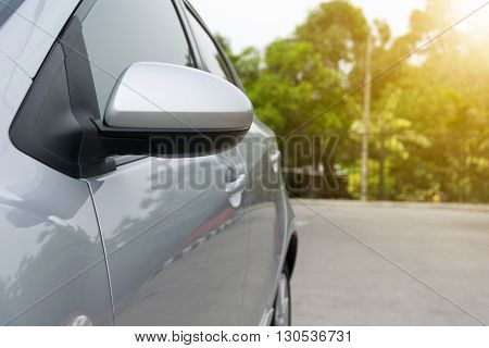 wing mirror of car. Sun shining. blur, transportation, vacation, glass,