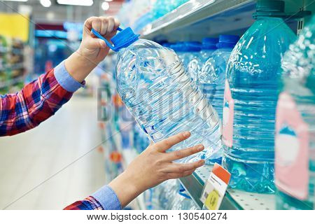 Woman Buys Bottle Drinking Water In Shop
