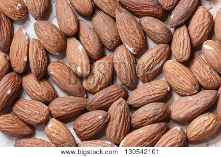 Many almonds without shell closeup background  macro