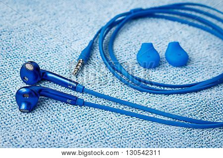 Earbuds and mini jack with earbud covers view from above