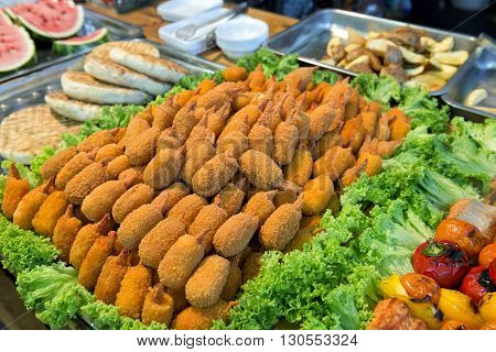 Breaded shrimp and other food on a street festival