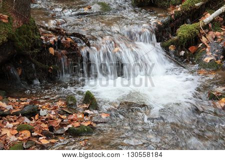 a picture of a waterfall flowing down