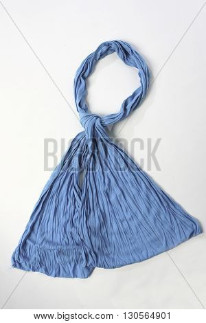 Twisted blue textile scarf on a white background