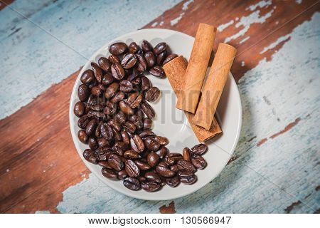 cinnamon and spillage of coffee beans a