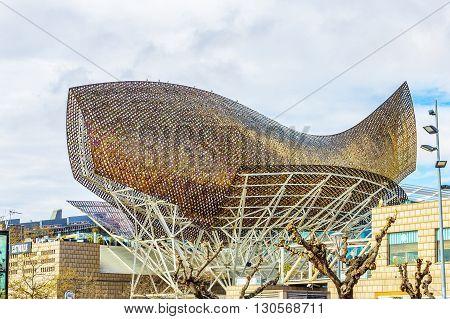 Golden Fish Sculpture In Port Olympic, Barcelona, Spain.