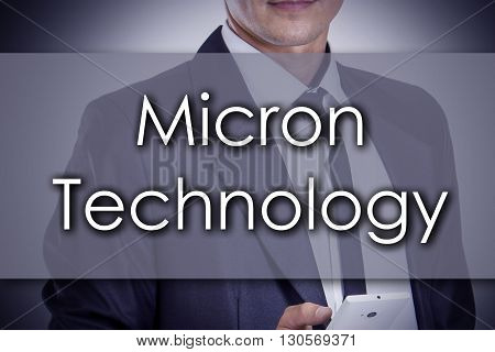 Micron Technology - Young Businessman With Text - Business Concept