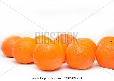 many fresh unrefined organic mandarin (tangerines) over white