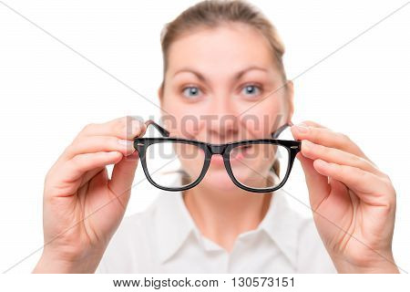 Woman With Poor Eyesight Wears Glasses, Focus On Glasses