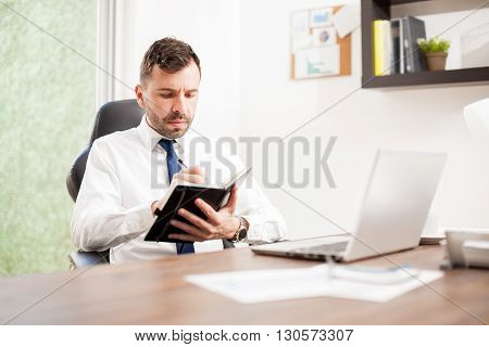 Accountant Writing On A Ledger