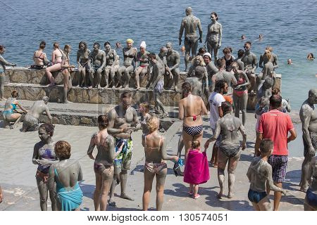 DALYAN TURKEY - AUGUST 20 2015 : Unidentified people are taking a mud bath. Mud baths are great for the skin.