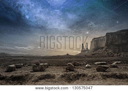 view of a rocky desert landscape at dusk