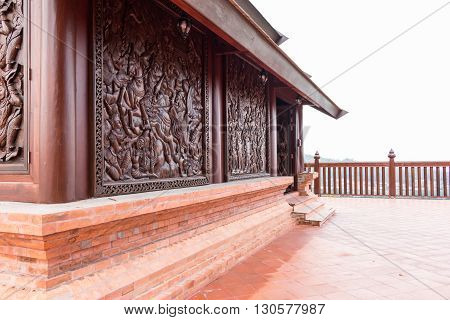 Wat Somdej Phu Ruea Ming Muang - The new temple in Thailand The base is made of clay and the wooden carving of Buddhist history.