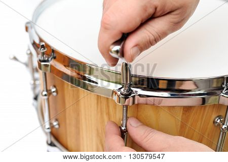 Master making new wooden snare drum isolated closeup