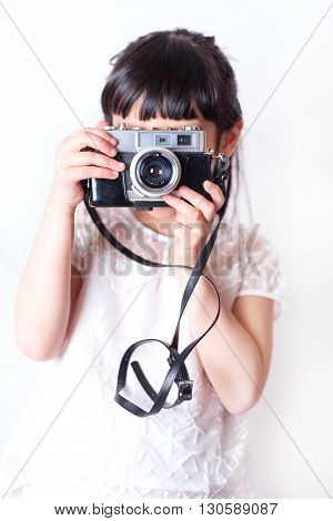Young person enjoy photographing with vintage camera.