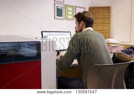 Male Designer Operating CAD System For Laser Cutter