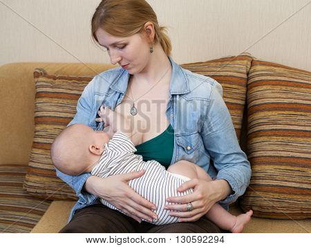 Close Up Young Woman Holding A Baby