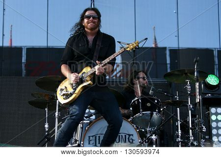 FRISCO, TX-APR 23: James Young (L) and Chris Thompson of the Eli Young Band performs onstage during the 2016 Off The Rails Music Festival - Day 1 at Toyota Stadium in Frisco, Texas