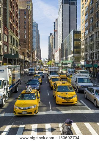 NEW YORK CITY - April 21 2016: Typcial street scene in Manhattan, Ave of the Americas. Rush hour with a lot of taxis, New York Citiy, Manhatten