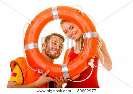 Happy lifeguards with ring buoy in life vest jacket. Man and woman having fun. Accident prevention.