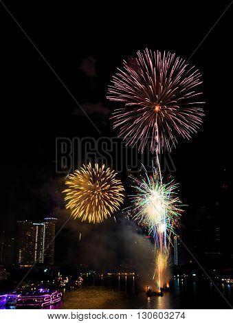 Fireworks over Chaopraya river near hotel in Bangkok Thailand